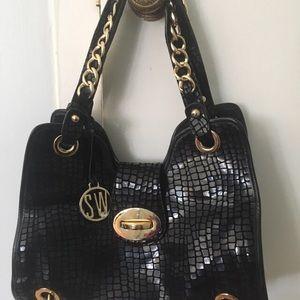 Stuart Weitzman black purse never worn